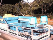 18' Voyager Sport Pontoon with a 40 HP Nissan Motor.
